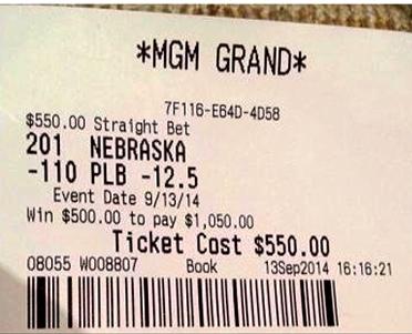 Warren Buffet's Sports Book Ticket on Nebraska -12.5