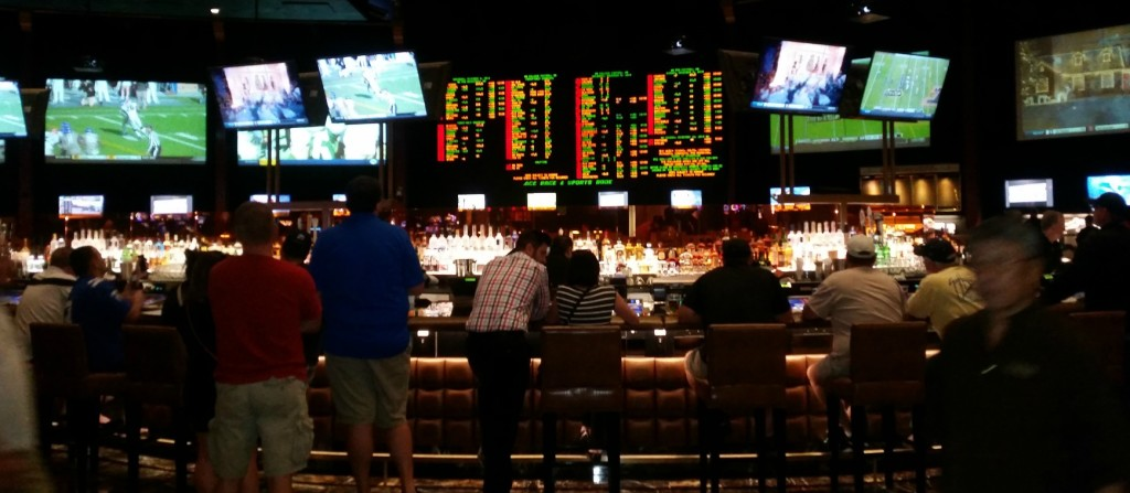Video Poker at the Bar May Yield a Nice TV Screen for Watching Hoops and Some Free Drinks Pictured: Caesars Palace Sports Book Bar